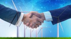 business handshake foran vindmøller